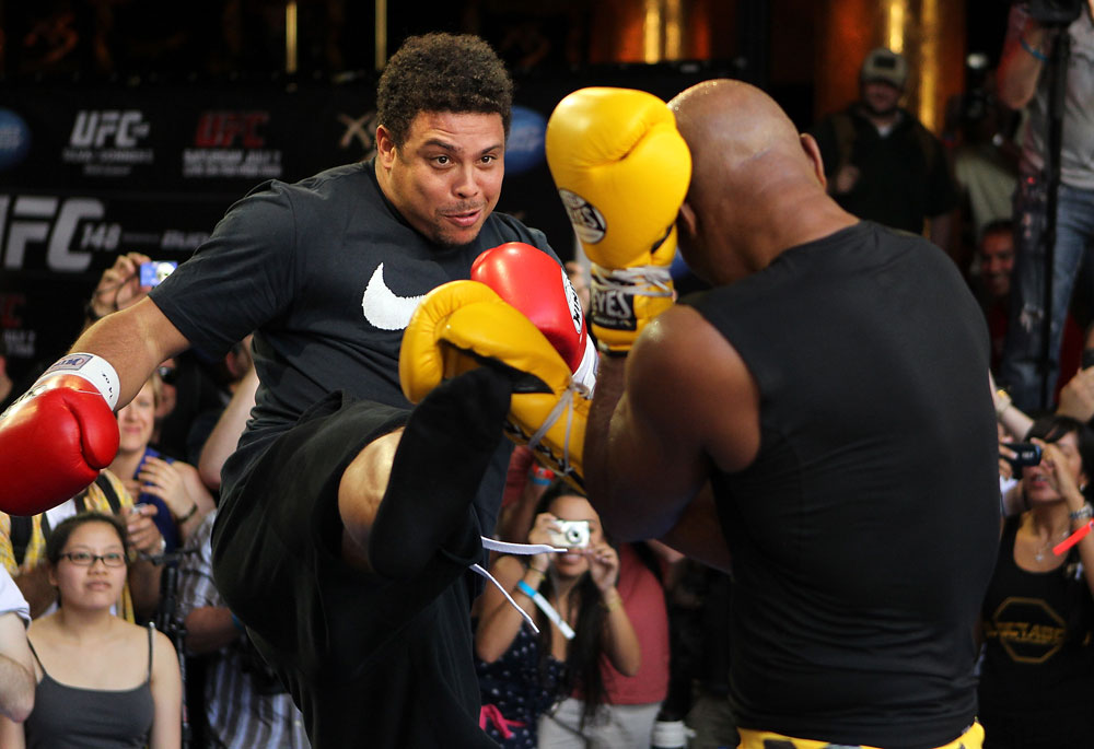 LAS VEGAS, NV - JULY 5:   (R-L) UFC Middleweight Champion Anderson Silva spars with Brazilian soccer legend Ronaldo during the UFC 148 Open Workouts inside XS nightclub at the Encore on July 5, 2012 in Las Vegas, Nevada.  (Photo by Josh Hedges/Zuffa LLC/Zuffa LLC via Getty Images)