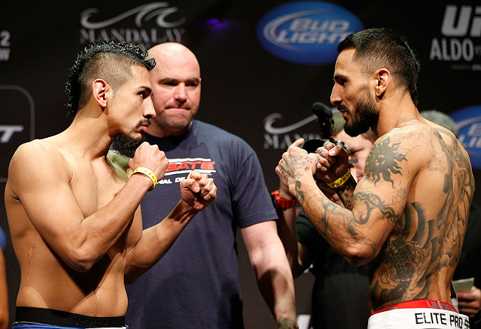 LAS VEGAS, NV - FEBRUARY 01:  (L-R) Opponents Edwin Figueroa and Francisco Rivera face off during the UFC 156 weigh-in on February 1, 2013 at Mandalay Bay Events Center in Las Vegas, Nevada.  (Photo by Josh Hedges/Zuffa LLC/Zuffa LLC via Getty Images)