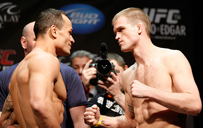 LAS VEGAS, NV - FEBRUARY 01:  (L-R) Opponents Gleison Tibau and Evan Dunham face off during the UFC 156 weigh-in on February 1, 2013 at Mandalay Bay Events Center in Las Vegas, Nevada.  (Photo by Josh Hedges/Zuffa LLC/Zuffa LLC via Getty Images)
