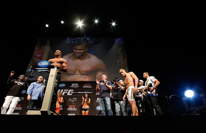 "LAS VEGAS, NV - FEBRUARY 01:  Alistair Overeem weighs in as his opponent Antonio ""Bigfoot"" Silva looks on during the UFC 156 weigh-in on February 1, 2013 at Mandalay Bay Events Center in Las Vegas, Nevada.  (Photo by Josh Hedges/Zuffa LLC/Zuffa LLC via Getty Images)"