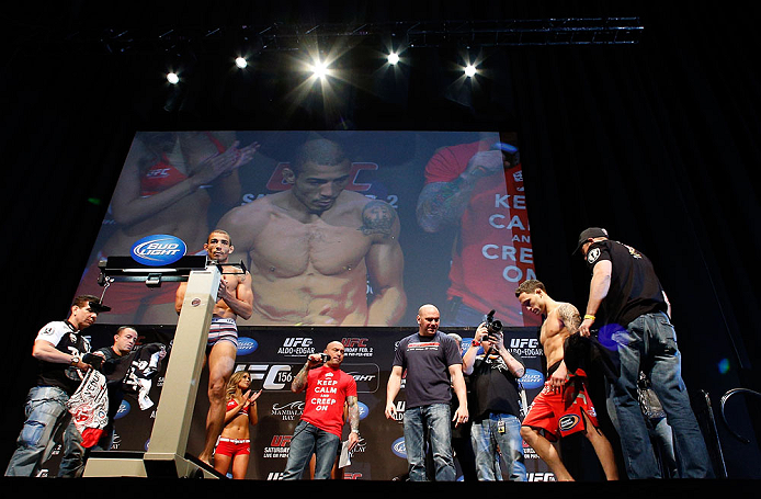 LAS VEGAS, NV - FEBRUARY 01:  Jose Aldo weighs in as opponent Frankie Edgar looks on during the UFC 156 weigh-in on February 1, 2013 at Mandalay Bay Events Center in Las Vegas, Nevada.  (Photo by Josh Hedges/Zuffa LLC/Zuffa LLC via Getty Images)