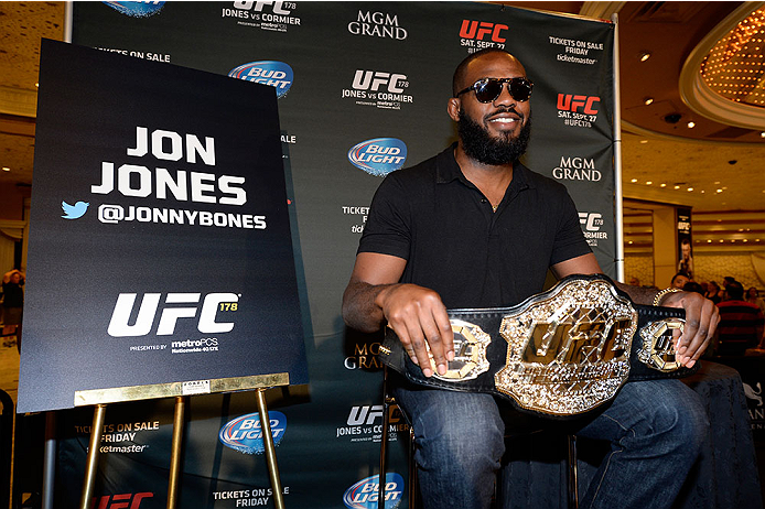 LAS VEGAS, NV - AUGUST 4:  UFC light heavyweight champion Jon Jones holds his championship belt for the fans during the UFC 178 Ultimate Media Day at the MGM Grand Hotel/Casino on August 4, 2014 in Las Vegas, Nevada. (Photo by Jeff Bottari/Zuffa LLC/Zuffa LLC via Getty Images)