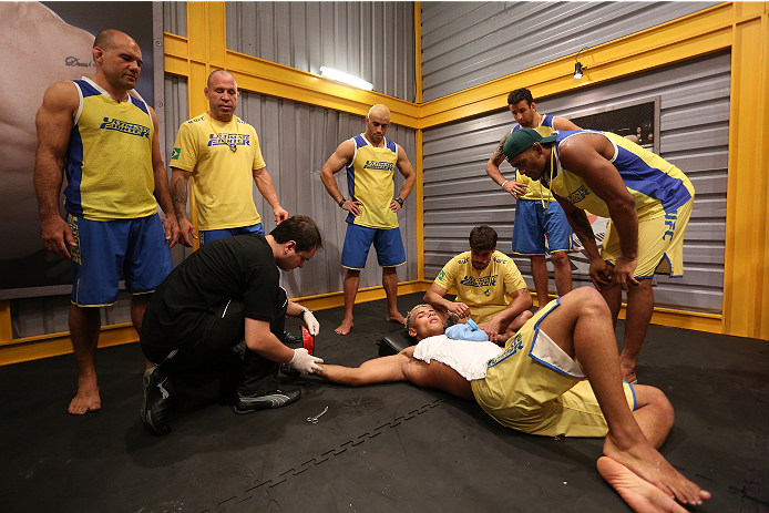 SAO PAULO, BRAZIL - JANUARY 30:  Team Wanderlei fighter Paulo Costa lies on the floor of the locker room after being defeated by Team Sonnen fighter Marcio Junior Team Sonnen fighter Marcio Junior in their middleweight fight during season three of The Ultimate Fighter Brazil on January 30, 2014 in Sao Paulo, Brazil. (Photo by Luiz Pires Dias/Zuffa LLC/Zuffa LLC via Getty Images) *** Local Caption *** Paulo Costa