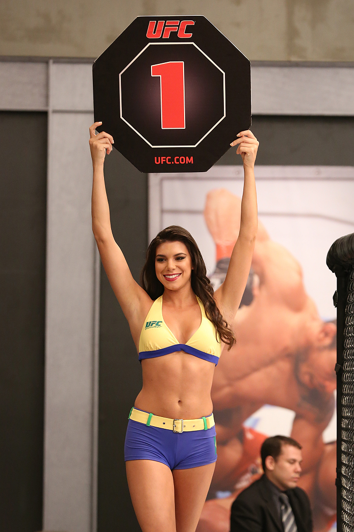 SAO PAULO, BRAZIL - FEBRUARY 4:  UFC Octagon Girl candidate Camila Bortolazzo signals the start of round one between Team Wanderlei fighter Antonio Branjao and Team Sonnen fighter Vitor Mirande in their heavyweight fight during season three of The Ultimate Fighter Brazil on February 4, 2014 in Sao Paulo, Brazil. (Photo by Luiz Pires Dias/Zuffa LLC/Zuffa LLC via Getty Images) *** Local Caption *** Camila Bortolazzo