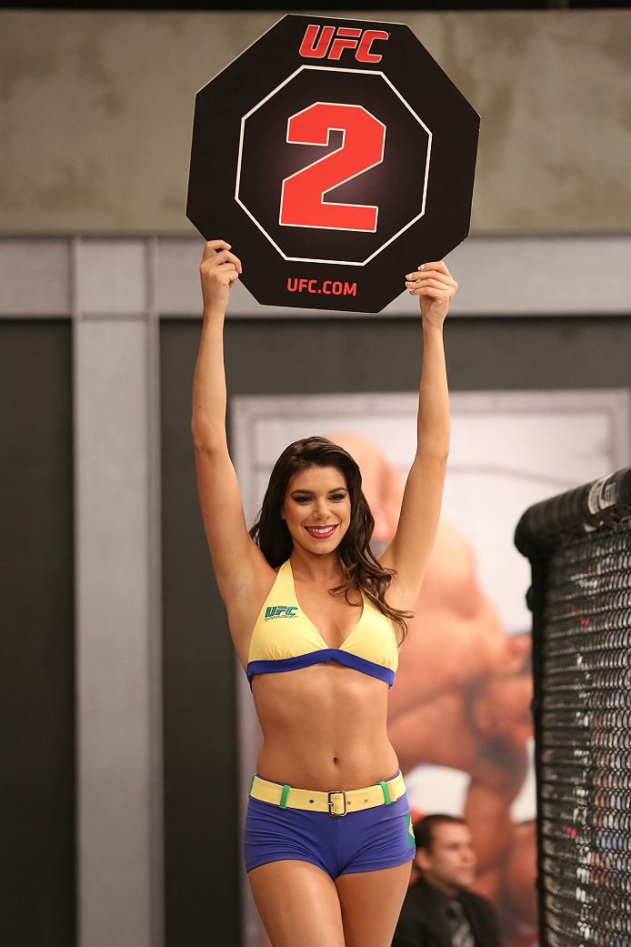 SAO PAULO, BRAZIL - FEBRUARY 4:  UFC Octagon Girl candidate Camila Bortolazzo signals the start of round two between Team Wanderlei fighter Antonio Branjao and Team Sonnen fighter Vitor Mirande in their heavyweight fight during season three of The Ultimate Fighter Brazil on February 4, 2014 in Sao Paulo, Brazil. (Photo by Luiz Pires Dias/Zuffa LLC/Zuffa LLC via Getty Images) *** Local Caption *** Camila Bortolazzo