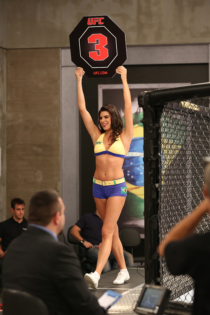 SAO PAULO, BRAZIL - FEBRUARY 4:  UFC Octagon Girl candidate Camila Bortolazzo signals the start of round three between Team Wanderlei fighter Antonio Branjao and Team Sonnen fighter Vitor Mirande in their heavyweight fight during season three of The Ultimate Fighter Brazil on February 4, 2014 in Sao Paulo, Brazil. (Photo by Luiz Pires Dias/Zuffa LLC/Zuffa LLC via Getty Images) *** Local Caption *** Camila Bortolazzo