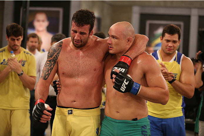SAO PAULO, BRAZIL - FEBRUARY 4:  (R-L) Team Sonnen fighter Vitor Mirande consoles Team Wanderlei fighter Antonio Branjao after Mirande defeated Branjao by knockout in their heavyweight fight during season three of The Ultimate Fighter Brazil on February 4, 2014 in Sao Paulo, Brazil. (Photo by Luiz Pires Dias/Zuffa LLC/Zuffa LLC via Getty Images) *** Local Caption *** Antonio Branjao; Vitor Mirande