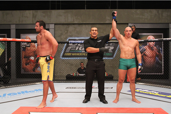 SAO PAULO, BRAZIL - FEBRUARY 4:  (R-L) Team Sonnen fighter Vitor Mirande celebrates after defeating Team Wanderlei fighter Antonio Branjao in their heavyweight fight during season three of The Ultimate Fighter Brazil on February 4, 2014 in Sao Paulo, Brazil. (Photo by Luiz Pires Dias/Zuffa LLC/Zuffa LLC via Getty Images) *** Local Caption *** Antonio Branjao; Vitor Mirande