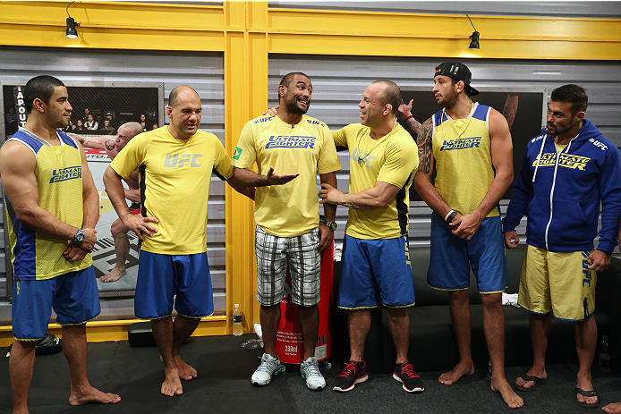 SAO PAULO, BRAZIL - FEBRUARY 8:  Guest coach Sergio Moraes (C) speaks with the Team Wanderlei fighters before Team Wanderlei fighter Jollyson Francino faces Team Sonnen fighter Marcos Rogerio in their heavyweight fight during season three of The Ultimate Fighter Brazil on February 8, 2014 in Sao Paulo, Brazil. (Photo by Luiz Pires Dias/Zuffa LLC/Zuffa LLC via Getty Images) *** Local Caption *** Sergio Moraes