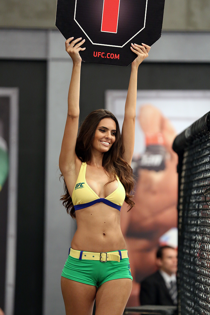 SAO PAULO, BRAZIL - FEBRUARY 8:  UFC Octagon Girl candidate Wendy Meira signals the start of round one between Team Wanderlei fighter Jollyson Francino and Team Sonnen fighter Marcos Rogerio in their heavyweight fight during season three of The Ultimate Fighter Brazil on February 8, 2014 in Sao Paulo, Brazil. (Photo by Luiz Pires Dias/Zuffa LLC/Zuffa LLC via Getty Images) *** Local Caption *** Wendy Meira