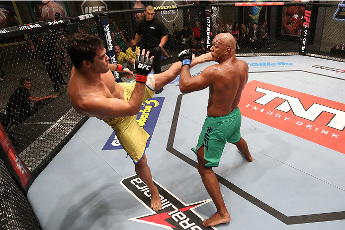 SAO PAULO, BRAZIL - FEBRUARY 8:  (L-R) Team Wanderlei fighter Jollyson Francino kicks Team Sonnen fighter Marcos Rogerio in their heavyweight fight during season three of The Ultimate Fighter Brazil on February 8, 2014 in Sao Paulo, Brazil. (Photo by Luiz Pires Dias/Zuffa LLC/Zuffa LLC via Getty Images) *** Local Caption *** Jollyson Francino; Marcos Rogerio