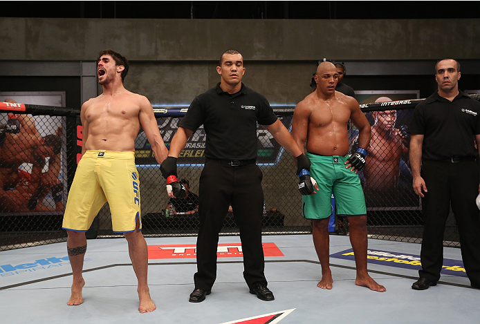 SAO PAULO, BRAZIL - FEBRUARY 15:  Team Wanderlei fighter Antonio Carlos Jr. celebrates after defeating Team Sonnen fighter Marcos Rogerio in their middleweight fight during season three of The Ultimate Fighter Brazil on February 15, 2014 in Sao Paulo, Brazil. (Photo by Luiz Pires Dias/Zuffa LLC/Zuffa LLC via Getty Images) *** Local Caption *** Antonio Carlos Jr.;Marcos Rogerio