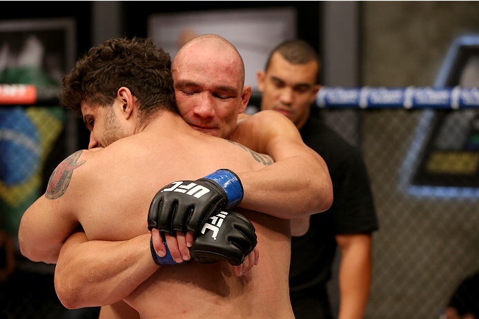 SAO PAULO, BRAZIL - FEBRUARY 17:  (R-L) Team Sonnen fighter Vitor Miranda hugs Team Wanderlei fighter Richardson Moreira after defeating him in their middleweight fight during season three of The Ultimate Fighter Brazil on February 17, 2014 in Sao Paulo, Brazil. (Photo by Luiz Pires Dias/Zuffa LLC/Zuffa LLC via Getty Images) *** Local Caption *** Vitor Miranda;Richardson Moreira