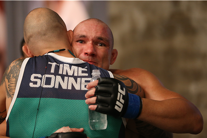 SAO PAULO, BRAZIL - FEBRUARY 17:  (R-L) Team Sonnen fighter Vitor Miranda hugs his teammate after defeating Team Wanderlei fighter Richardson Moreira in their middleweight fight during season three of The Ultimate Fighter Brazil on February 17, 2014 in Sao Paulo, Brazil. (Photo by Luiz Pires Dias/Zuffa LLC/Zuffa LLC via Getty Images) *** Local Caption *** Vitor Miranda