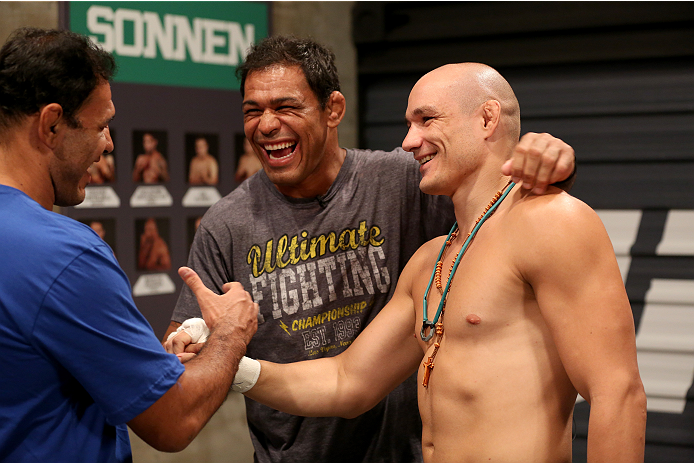 SAO PAULO, BRAZIL - FEBRUARY 17:  (L-R) Rogerio Nogueira and Antonio Rodrigo 'Minotauro' Nogueira  talk with Team Sonnen fighter Vitor Miranda before facing Team Wanderlei fighter Richardson Moreira in their middleweight fight during season three of The Ultimate Fighter Brazil on February 17, 2014 in Sao Paulo, Brazil. (Photo by Luiz Pires Dias/Zuffa LLC/Zuffa LLC via Getty Images) *** Local Caption *** Vitor Miranda;Rogerio Nogueira;Antonio Rodrigo 'Minotauro' Nogueira