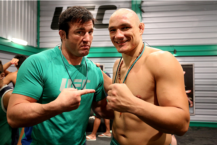 SAO PAULO, BRAZIL - FEBRUARY 17:  Head Coach Chanel Sonnen takes a picture with Team Sonnen fighter Vitor Miranda after defeating Team Wanderlei fighter Richardson Moreira in their middleweight fight during season three of The Ultimate Fighter Brazil on February 17, 2014 in Sao Paulo, Brazil. (Photo by Luiz Pires Dias/Zuffa LLC/Zuffa LLC via Getty Images) *** Local Caption *** Chanel Sonnen;Vitor Miranda