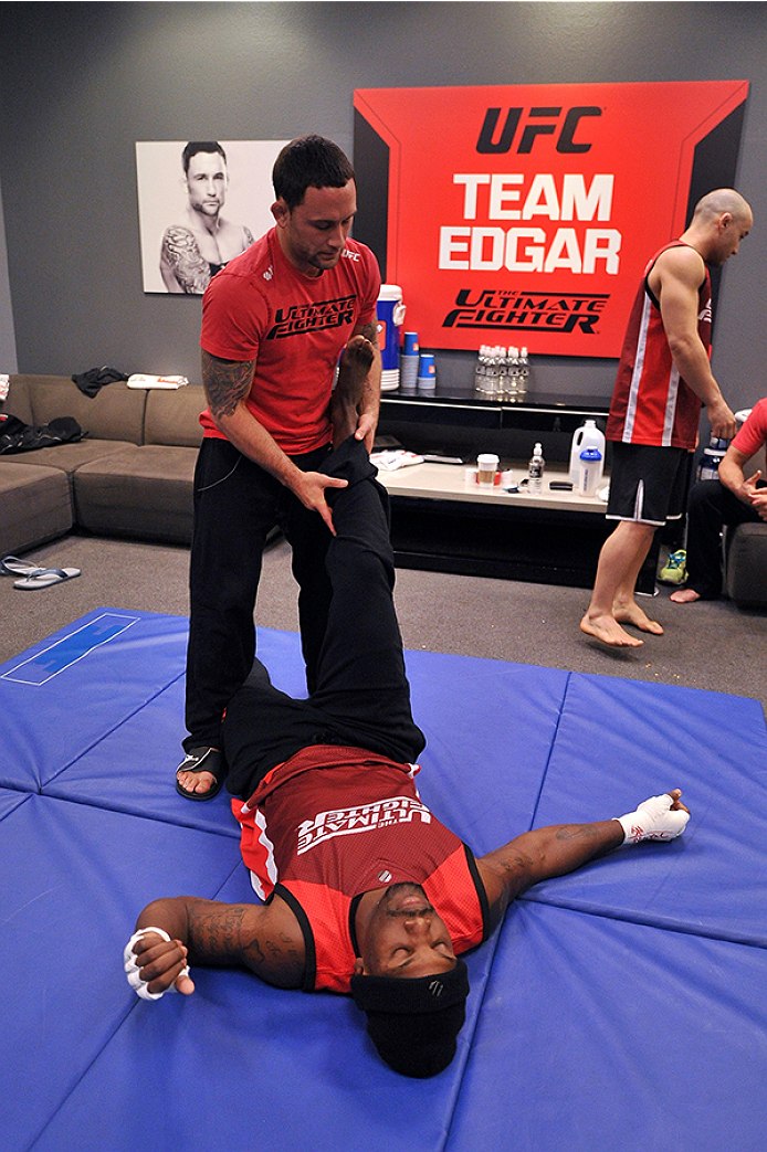 LAS VEGAS, NV - OCTOBER 29:  (L-R) Coach Frankie Edgar stretches his fighter Todd Monaghan before he faces Team Penn fighter Daniel Spohn in their preliminary fight during filming of season nineteen of The Ultimate Fighter on October 29, 2013 in Las Vegas, Nevada. (Photo by Jeff Bottari/Zuffa LLC/Zuffa LLC via Getty Images) *** Local Caption *** Frankie Edgar; Todd Monaghan