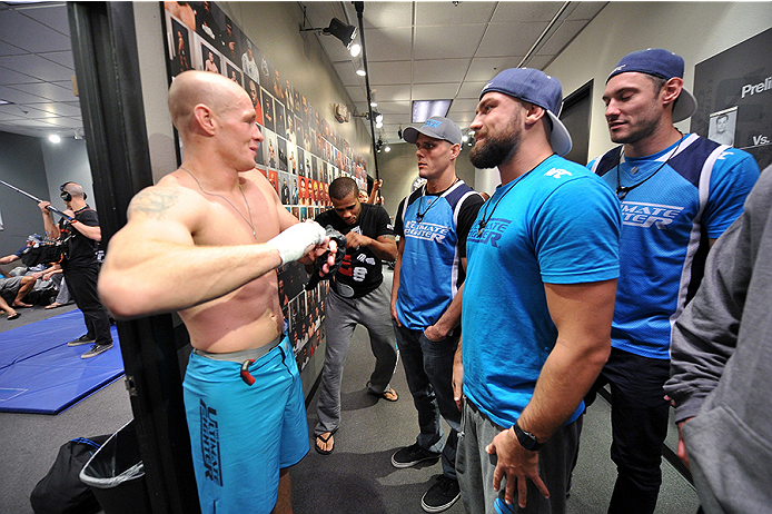 LAS VEGAS, NV - OCTOBER 29:  (L-R) Team Penn fighter Daniel Spohn celebrates with his team outside of the locker room after defeating Team Edgar fighter Todd Monaghan in their preliminary fight during filming of season nineteen of The Ultimate Fighter on October 29, 2013 in Las Vegas, Nevada. (Photo by Jeff Bottari/Zuffa LLC/Zuffa LLC via Getty Images) *** Local Caption ***Daniel Spohn