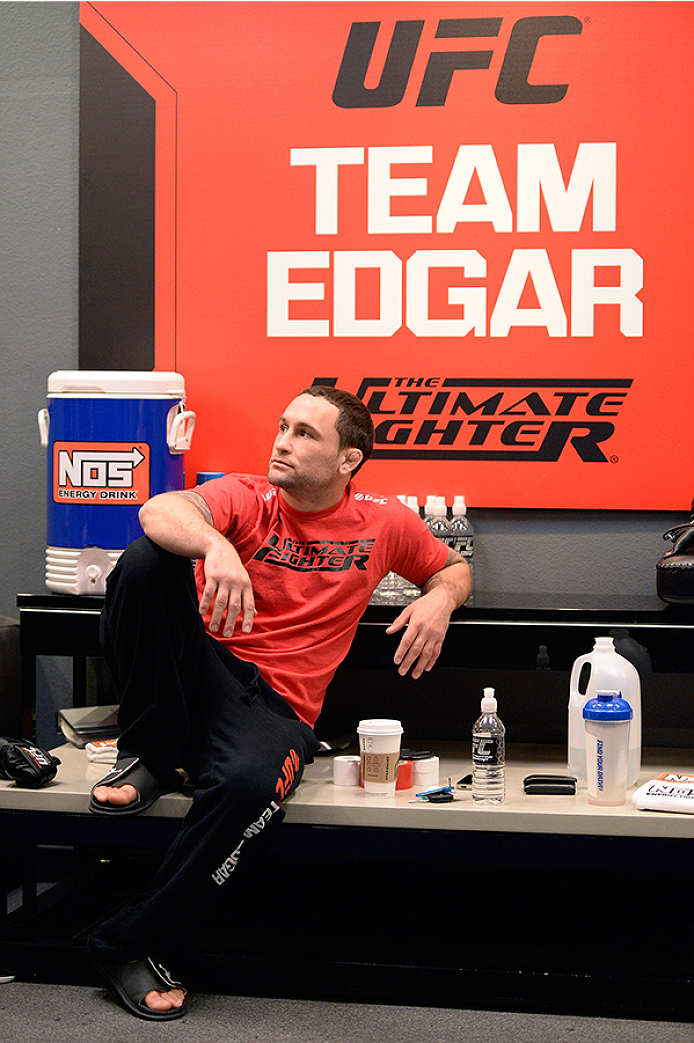 LAS VEGAS, NV - OCTOBER 29:  Coach Frankie Edgar sits in the locker room before his fighter Todd Monaghan faces Team Penn fighter Daniel Spohn in their preliminary fight during filming of season nineteen of The Ultimate Fighter on October 29, 2013 in Las Vegas, Nevada. (Photo by Jeff Bottari/Zuffa LLC/Zuffa LLC via Getty Images) *** Local Caption *** Frankie Edgar