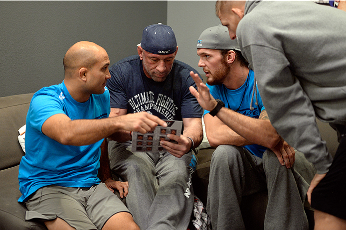 LAS VEGAS, NV - OCTOBER 29:  (L-R) Coach BJ Penn discusses the choices for the next matchup with wrestling coach Mark Coleman and middleweight fighter Mike King after Team Penn fighter Daniel Spohn defeated Team Edgar fighter Todd Monaghan in their preliminary fight during filming of season nineteen of The Ultimate Fighter on October 29, 2013 in Las Vegas, Nevada. (Photo by Jeff Bottari/Zuffa LLC/Zuffa LLC via Getty Images) *** Local Caption ***BJ Penn; Mark Coleman; Mike King