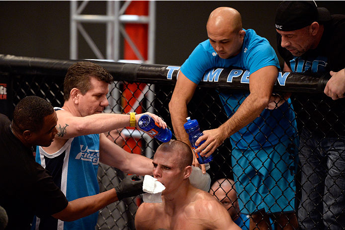 LAS VEGAS, NV - NOVEMBER 1:  (L-R) Team Penn jiu jitsu coach Andre Pederneiras hydrates team Penn fighter Tim Williams as coach BJ Penn ices him between rounds against team Edgar fighter Dhiego Lima in their preliminary fight during filming of season nineteen of The Ultimate Fighter on November 1, 2013 in Las Vegas, Nevada. (Photo by Jeff Bottari/Zuffa LLC/Zuffa LLC via Getty Images) *** Local Caption *** Andre Pederneiras; Tim Williams; BJ Penn