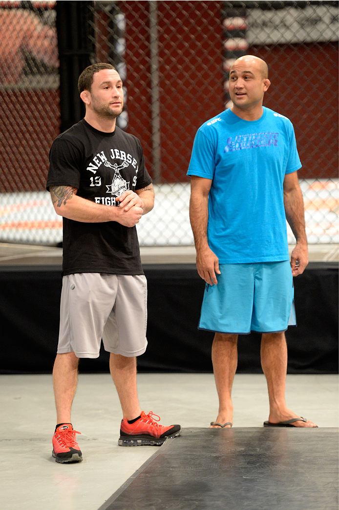 LAS VEGAS, NV - NOVEMBER 1:  (L-R) Coach Frankie Edgar and coach BJ Penn announce the upcoming fight for the next episode during filming of season nineteen of The Ultimate Fighter on November 1, 2013 in Las Vegas, Nevada. (Photo by Jeff Bottari/Zuffa LLC/Zuffa LLC via Getty Images) *** Local Caption *** BJ Penn; Frankie Edgar