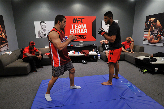 LAS VEGAS, NV - NOVEMBER 1:  (L-R) Team Edgar muay thai coach Michael Costa warms up with team Edgar fighter Dhiego Lima in their preliminary fight during filming of season nineteen of The Ultimate Fighter on November 1, 2013 in Las Vegas, Nevada. (Photo by Jeff Bottari/Zuffa LLC/Zuffa LLC via Getty Images) *** Local Caption *** Dhiego Lima; Michael Costa