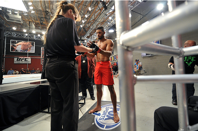 LAS VEGAS, NV - NOVEMBER 1:  (R-L) Team Edgar fighter Dhiego Lima is inspected by referee Kim Winslow before facing team Penn fighter Tim Williams in their preliminary fight during filming of season nineteen of The Ultimate Fighter on November 1, 2013 in Las Vegas, Nevada. (Photo by Jeff Bottari/Zuffa LLC/Zuffa LLC via Getty Images) *** Local Caption *** Dhiego Lima; Kim Winslow