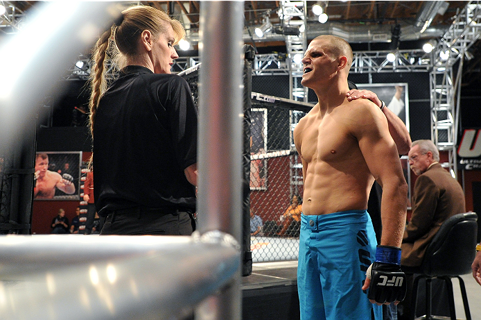 LAS VEGAS, NV - NOVEMBER 1:  (R-L) Team Penn fighter Tim Williams is inspected by referee Kim Winslow before entering the Octagon before facing team Edgar fighter Dhiego Williams in their preliminary fight during filming of season nineteen of The Ultimate Fighter on November 1, 2013 in Las Vegas, Nevada. (Photo by Jeff Bottari/Zuffa LLC/Zuffa LLC via Getty Images) *** Local Caption *** Tim Williams; Kim Winslow