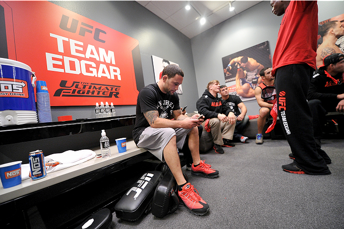 LAS VEGAS, NV - NOVEMBER 1:  Coach Frankie Edgar sits in the locker room after his fighter Dhiego Lima defeated team Penn fighter Tim Williams in their preliminary fight during filming of season nineteen of The Ultimate Fighter on November 1, 2013 in Las Vegas, Nevada. (Photo by Jeff Bottari/Zuffa LLC/Zuffa LLC via Getty Images) *** Local Caption *** Frankie Edgar