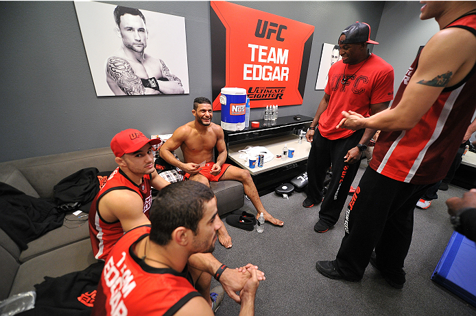 LAS VEGAS, NV - NOVEMBER 1:  Team Edgar fighter Dhiego Lima celebrates with teammates and coaches in the locker room after defeating team Penn fighter Tim Williams in their preliminary fight during filming of season nineteen of The Ultimate Fighter on November 1, 2013 in Las Vegas, Nevada. (Photo by Jeff Bottari/Zuffa LLC/Zuffa LLC via Getty Images) *** Local Caption *** Dhiego Lima