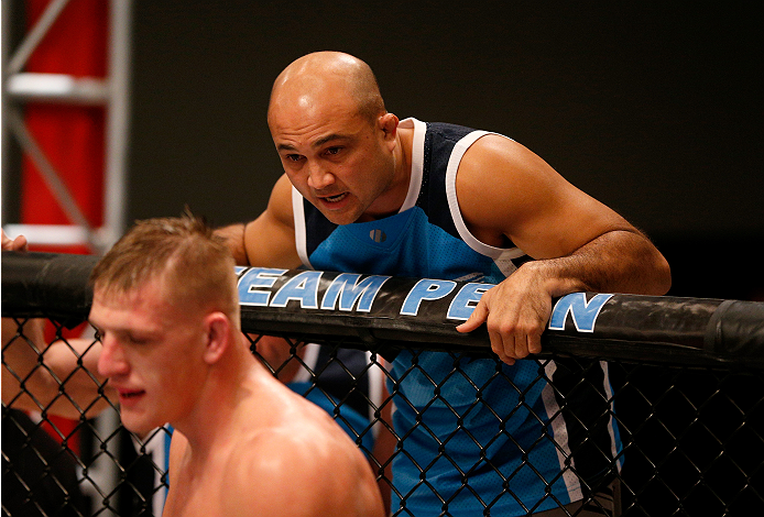 LAS VEGAS, NV - NOVEMBER 12:  (R-L) Head Coach BJ Penn gives advice to team Penn fighter Anton Berzin in between rounds against team Edgar fighter Patrick Walsh in their preliminary fight during filming of season nineteen of The Ultimate Fighter on November 12, 2013 in Las Vegas, Nevada. (Photo by Josh Hedges/Zuffa LLC/Zuffa LLC via Getty Images) *** Local Caption *** Anton Berzin;BJ Penn