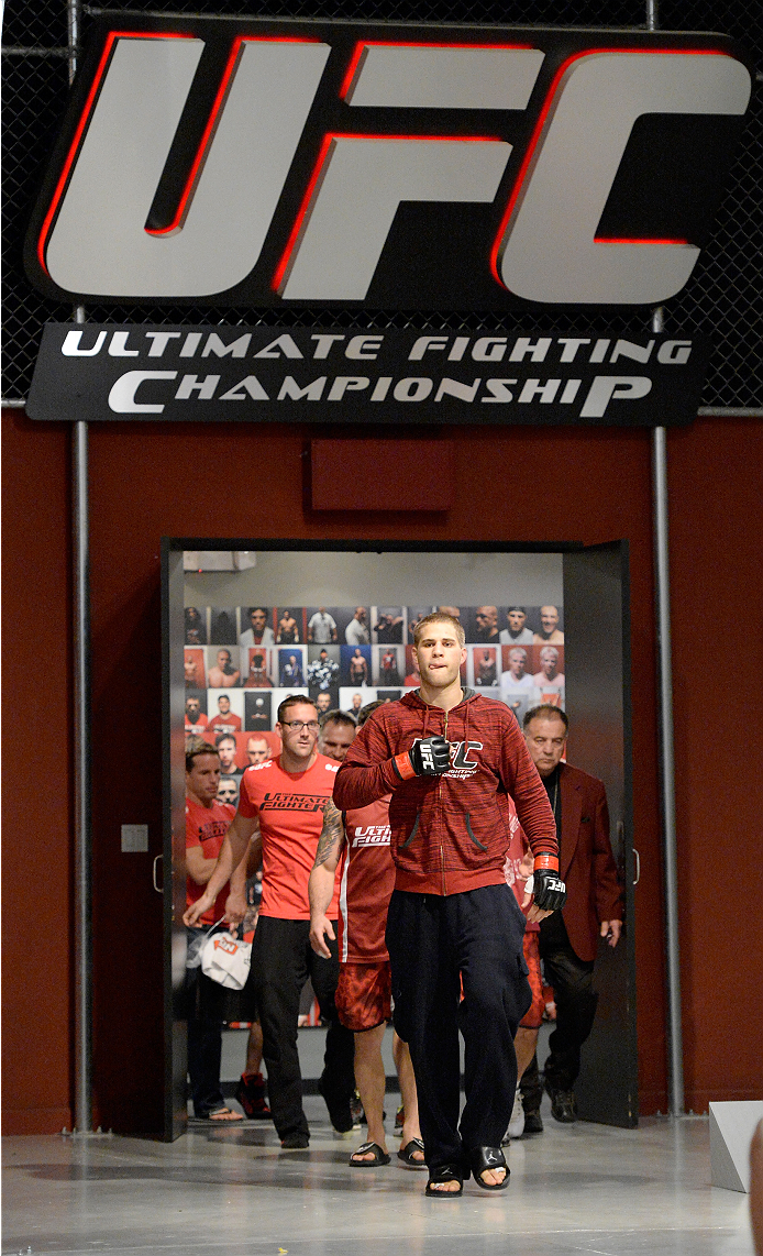 LAS VEGAS, NV - NOVEMBER 15: Team Edgar fighter Matt Van Buren walks to the Octagon to fight team Penn fighter Chris Fields in their preliminary fight during filming of season nineteen of The Ultimate Fighter on November 15, 2013 in Las Vegas, Nevada. (Photo by Jeff Bottari/Zuffa LLC/Zuffa LLC via Getty Images) *** Local Caption *** Matt Van Buren
