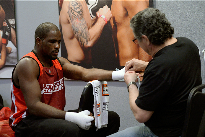 LAS VEGAS, NV - NOVEMBER 21:  Team Edgar fighter Corey Anderson gets his hands wrapped before facing team Edgar fighter Patrick Walsh in their semi-final fight during filming of season nineteen of The Ultimate Fighter on November 21, 2013 in Las Vegas, Nevada. (Photo by Jeff Bottari/Zuffa LLC/Zuffa LLC via Getty Images) *** Local Caption *** Corey Anderson