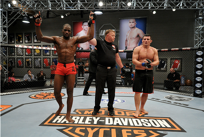 LAS VEGAS, NV - NOVEMBER 21: (L-R) Team Edgar fighter Corey Anderson celebrates his victory team Edgar fighter Patrick Walsh in their semi-final fight during filming of season nineteen of The Ultimate Fighter on November 21, 2013 in Las Vegas, Nevada. (Photo by Jeff Bottari/Zuffa LLC/Zuffa LLC via Getty Images) *** Local Caption *** Corey Anderson;Patrick Walsh