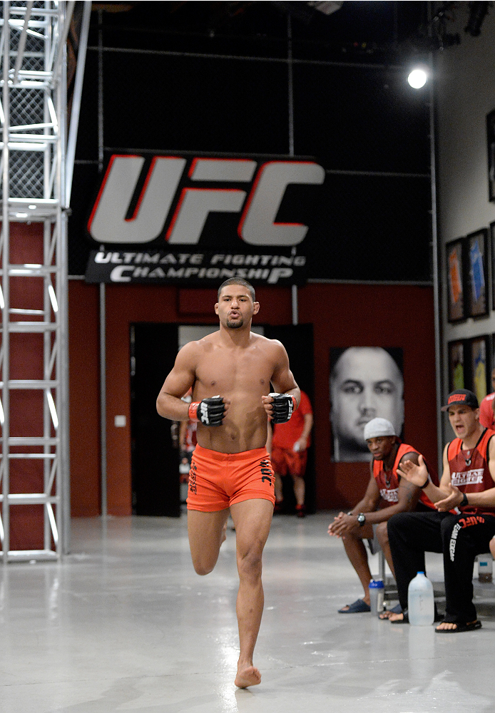 LAS VEGAS, NV - NOVEMBER 21:  Team Edgar fighter Dhiego Lima runs out to the Octagon before facing team Penn fighter Roger Zapata in their semi-final fight during filming of season nineteen of The Ultimate Fighter on November 21, 2013 in Las Vegas, Nevada. (Photo by Jeff Bottari/Zuffa LLC/Zuffa LLC via Getty Images) *** Local Caption *** Dhiego Lima