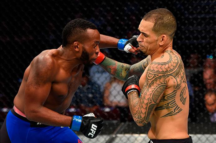 CLEVELAND, OH - SEPTEMBER 10:  (R-L) Yancy Medeiros punches Sean Spencer in their welterweight bout during the UFC 203 event at Quicken Loans Arena on September 10, 2016 in Cleveland, Ohio. (Photo by Josh Hedges/Zuffa LLC/Zuffa LLC via Getty Images)
