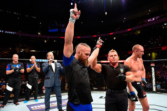 CLEVELAND, OH - SEPTEMBER 10:  (L-R) Nik Lentz celebrates after submitting Michael McBride in their lightweight bout during the UFC 203 event at Quicken Loans Arena on September 10, 2016 in Cleveland, Ohio. (Photo by Josh Hedges/Zuffa LLC/Zuffa LLC via Getty Images)
