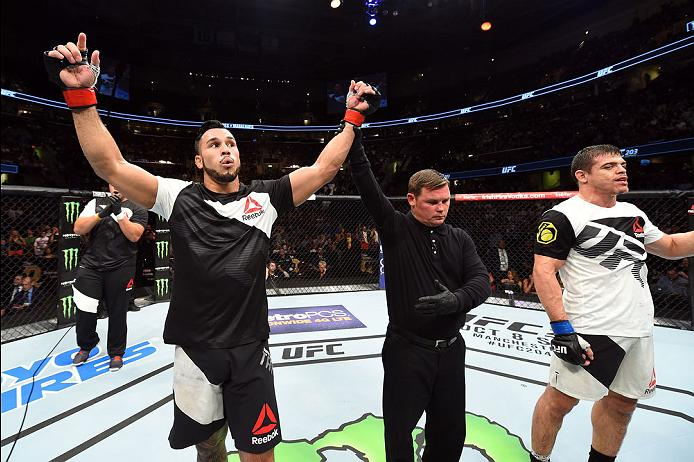 CLEVELAND, OH - SEPTEMBER 10:  (L-R) Brad Tavares celebrates after defeating Caio Magalhaes of Brazil by split decision in their middleweight bout during the UFC 203 event at Quicken Loans Arena on September 10, 2016 in Cleveland, Ohio. (Photo by Josh Hedges/Zuffa LLC/Zuffa LLC via Getty Images)