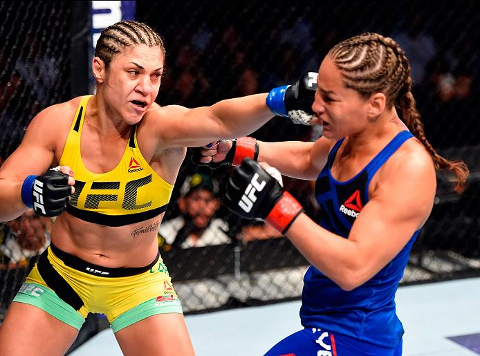 CLEVELAND, OH - SEPTEMBER 10:  (L-R) Bethe Correia of Brazil punches Jessica Eye in their women's bantamweight bout during the UFC 203 event at Quicken Loans Arena on September 10, 2016 in Cleveland, Ohio. (Photo by Josh Hedges/Zuffa LLC/Zuffa LLC via Getty Images)