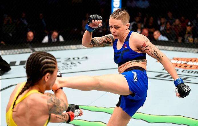 CLEVELAND, OH - SEPTEMBER 10:  (R-L) Joanne Calderwood of Scotland kicks Jessica Andrade of Brazil in their strawweight bout during the UFC 203 event at Quicken Loans Arena on September 10, 2016 in Cleveland, Ohio. (Photo by Josh Hedges/Zuffa LLC/Zuffa LLC via Getty Images)