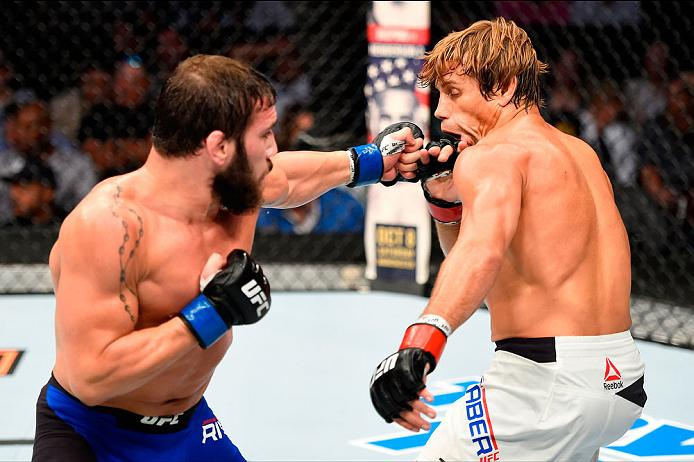 CLEVELAND, OH - SEPTEMBER 10:  (L-R) Jimmie Rivera punches Urijah Faber in their bantamweight bout during the UFC 203 event at Quicken Loans Arena on September 10, 2016 in Cleveland, Ohio. (Photo by Josh Hedges/Zuffa LLC/Zuffa LLC via Getty Images)