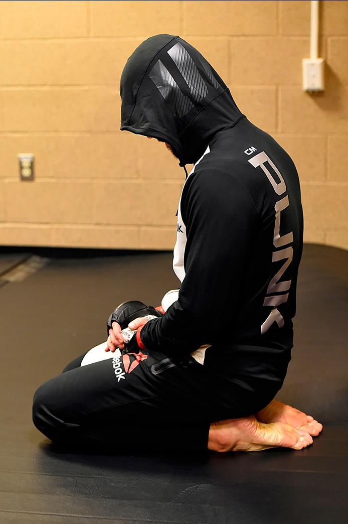 CLEVELAND, OH - SEPTEMBER 10:  Phil 'CM Punk' Brooks warms up backstage during the UFC 203 event at Quicken Loans Arena on September 10, 2016 in Cleveland, Ohio. (Photo by Mike Roach/Zuffa LLC/Zuffa LLC via Getty Images)