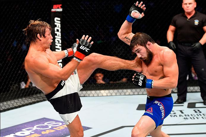 CLEVELAND, OH - SEPTEMBER 10:  (L-R) Urijah Faber kicks Jimmie Rivera in their bantamweight bout during the UFC 203 event at Quicken Loans Arena on September 10, 2016 in Cleveland, Ohio. (Photo by Josh Hedges/Zuffa LLC/Zuffa LLC via Getty Images)