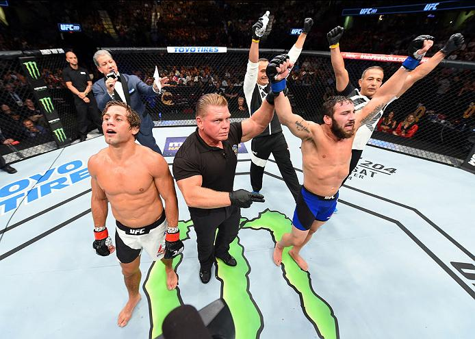 CLEVELAND, OH - SEPTEMBER 10:  (R-L) Jimmie Rivera celebrates after defeating Urijah Faber in their bantamweight bout during the UFC 203 event at Quicken Loans Arena on September 10, 2016 in Cleveland, Ohio. (Photo by Josh Hedges/Zuffa LLC/Zuffa LLC via Getty Images)