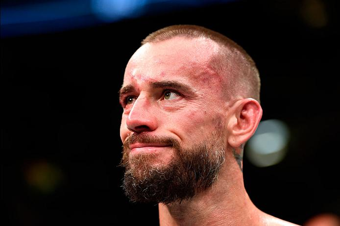 CLEVELAND, OH - SEPTEMBER 10:  Phil 'CM Punk' Brooks stands in the Octagon after being defeated by Mickey Gall by submission in their welterweight bout during the UFC 203 event at Quicken Loans Arena on September 10, 2016 in Cleveland, Ohio. (Photo by Josh Hedges/Zuffa LLC/Zuffa LLC via Getty Images)
