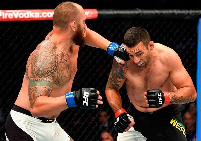 CLEVELAND, OH - SEPTEMBER 10:  (L-R) Travis Browne punches Fabricio Werdum of Brazil in their heavyweight bout during the UFC 203 event at Quicken Loans Arena on September 10, 2016 in Cleveland, Ohio. (Photo by Josh Hedges/Zuffa LLC/Zuffa LLC via Getty Images)
