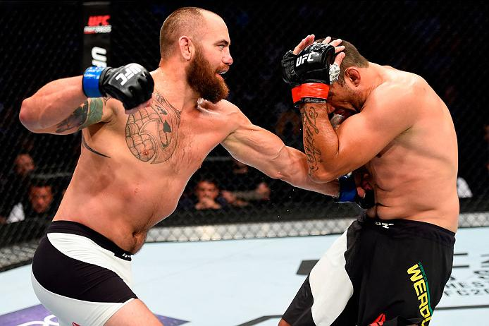 Travis Browne punches former champ Fabricio Werdum during their bout at UFC 203