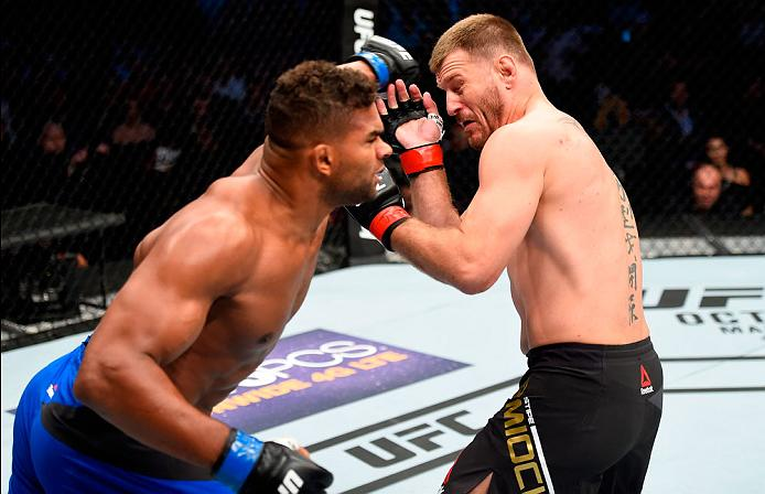CLEVELAND, OH - SEPTEMBER 10:  (L-R) Alistair Overeem of The Netherlands punches Stipe Miocic in their UFC heavyweight championship bout during the UFC 203 event at Quicken Loans Arena on September 10, 2016 in Cleveland, Ohio. (Photo by Josh Hedges/Zuffa LLC/Zuffa LLC via Getty Images)