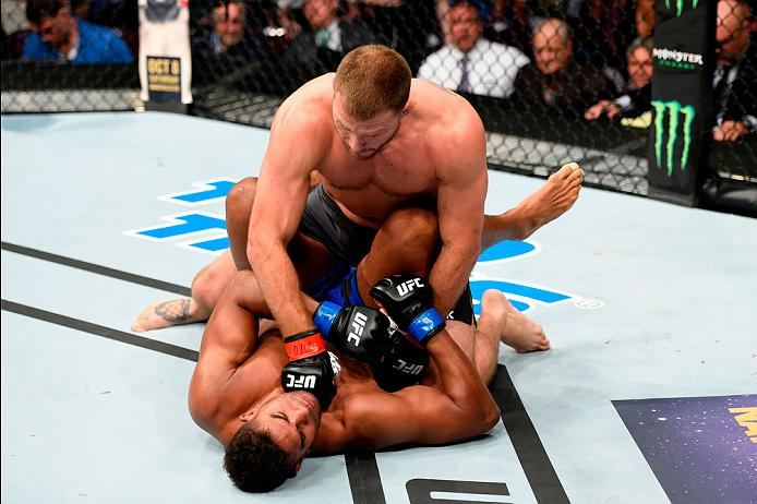 Stipe Miocic earns a TKO win over Alistair Overeem at UFC 203 to defend his heavyweight title